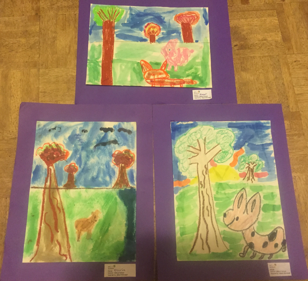 3rd Graders paint a landscape using watercolors and oil pastels, inspired by Albert Bierstadt's Buffalo Trail.