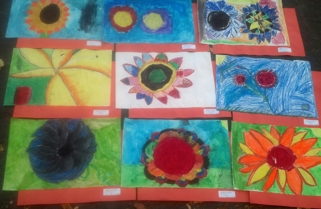 "4th Graders paint their own flower close-ups, inspired by Georgia O'Keeffe's ""Poppies."""