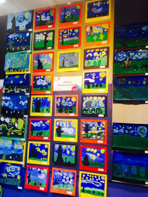 In the downtown Redwood City library: 3rd Grade students paint their version of a nighttime scene, inspired by Vincent Van Gogh's Starry Night.
